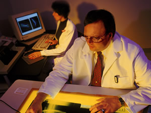 Man inspecting medical imaging.